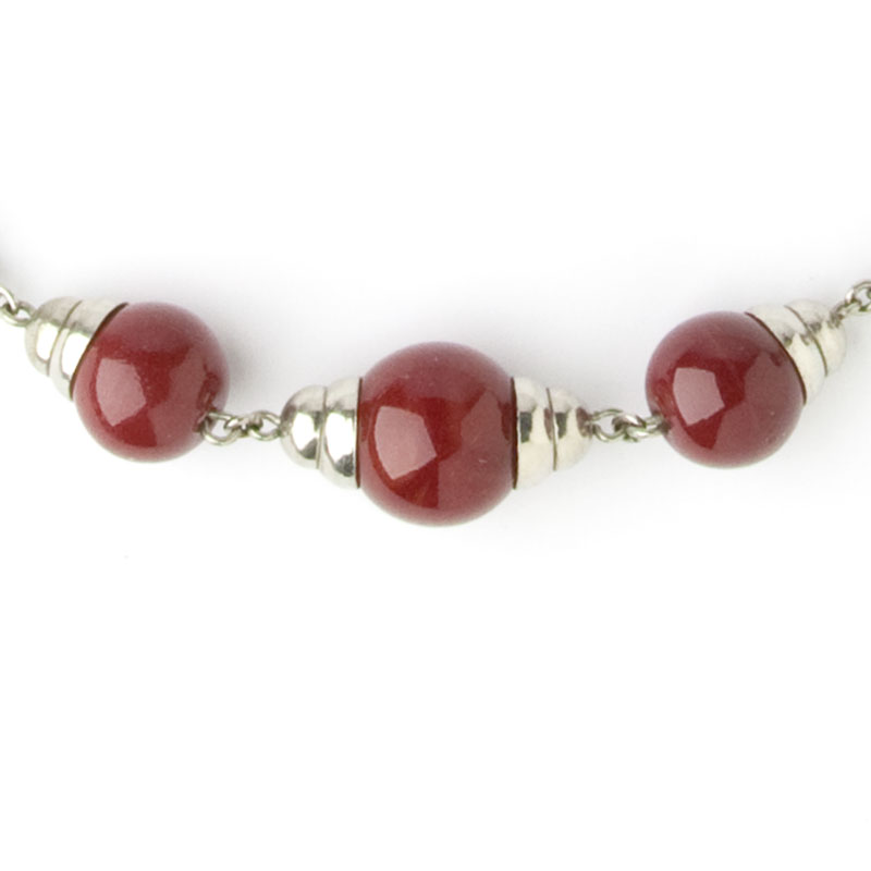 Red glass balls & chrome accents in necklace center