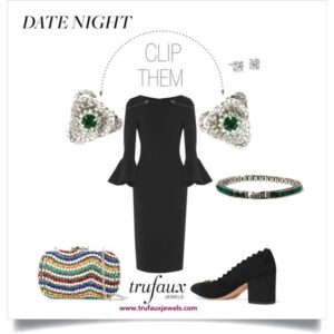 Dress clips at neckline of black dress with emerald bracelet