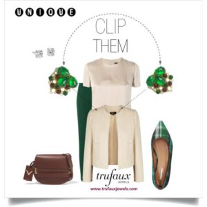 Dress clips on neckline of cream jacket with emerald pants