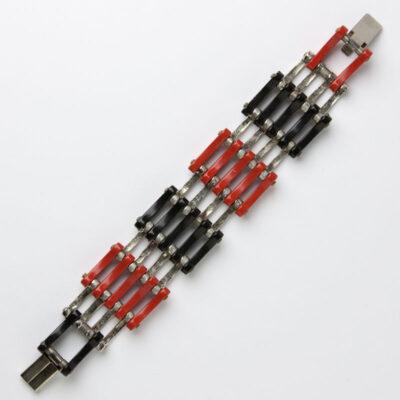 Back of red, black, & chrome grill bracelet