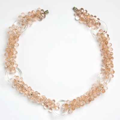 Pink bead necklace with clear glass rings