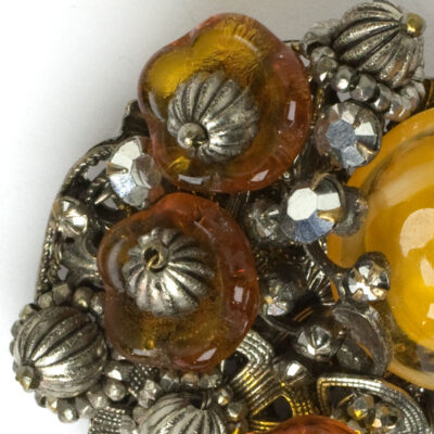 Close-up view of topaz glass flowers & silver beads