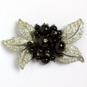 Floral brooch by Miriam Haskell with black glass beads
