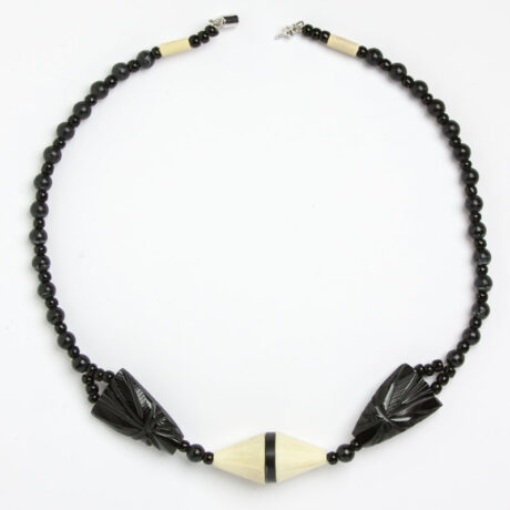 Front view of black & cream vintage necklace