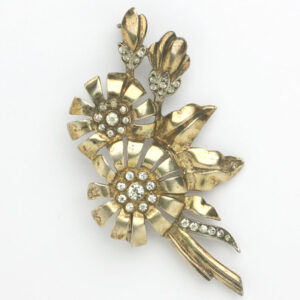 Gold plated flower brooch with diamante by Otis