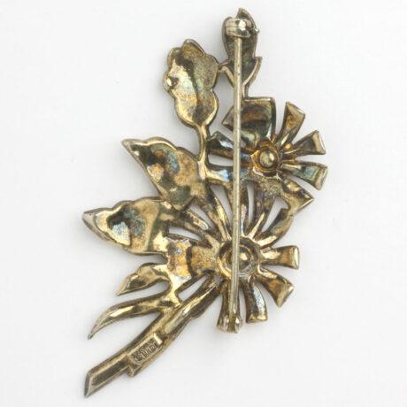 Back of gold-plated Otis flower brooch
