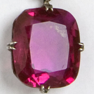 Close-up view of faceted ruby glass stone