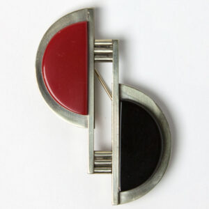 Costume brooch in red, black and chrome Machine Age design