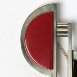 Close-up view of red Galalith on Bengel brooch