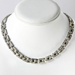 German necklace with diamanté in tank track design