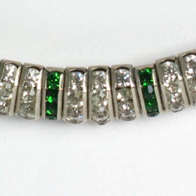 Close-up view of vertical links with emerald stones and diamante