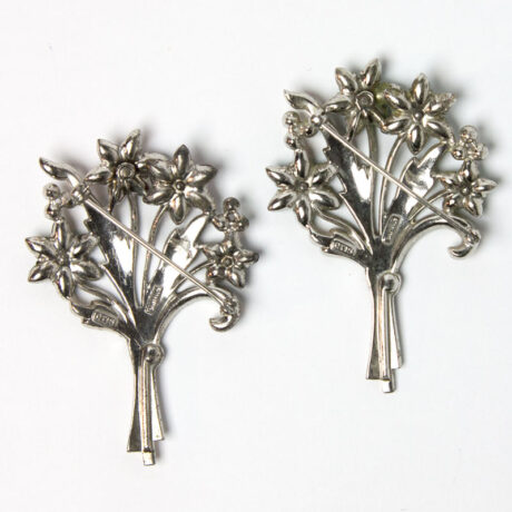 Back of pair of Otis sterling bouquet brooches