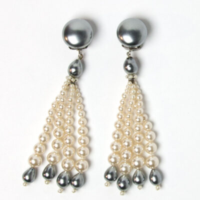 Close-up view of pearl tassel earrings
