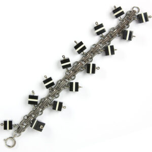 Art Deco tank-track pattern bracelet with charms