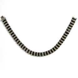 Front of black Bakelite Machine Age necklace