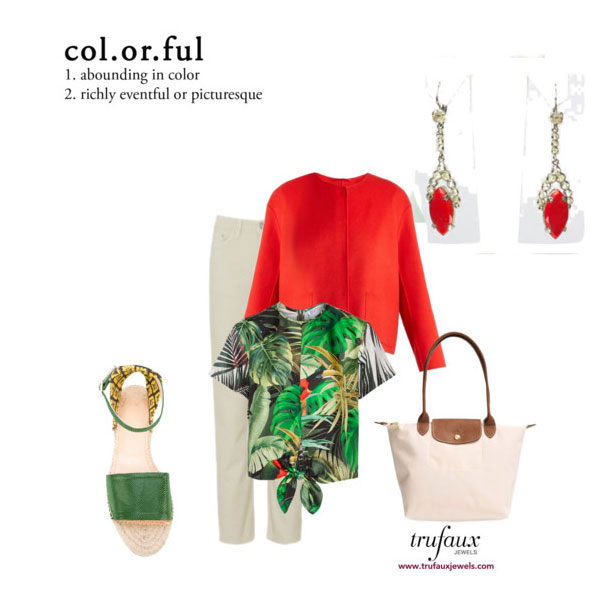 Lipstick-red dangly earrings paired with pants outfit in warm colors