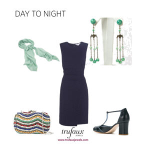 Navy sheath paired with warm colored accessories, including green bead Czech chandelier earrings