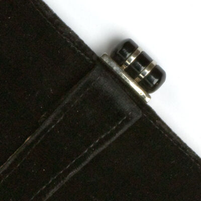 Close-up view of black Bakelite & chrome clasp