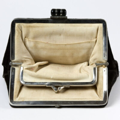 Purse interior, showing fixed change purse