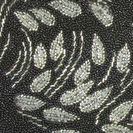Close-up view of silver beaded floral design on front