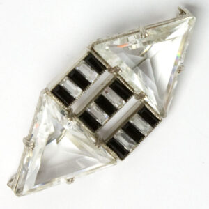 Crystal brooch with onyx stripes