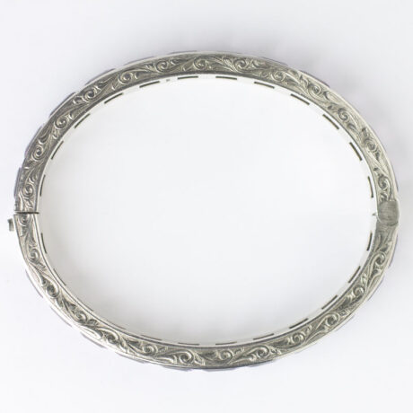 View of engraved sterling silver edges