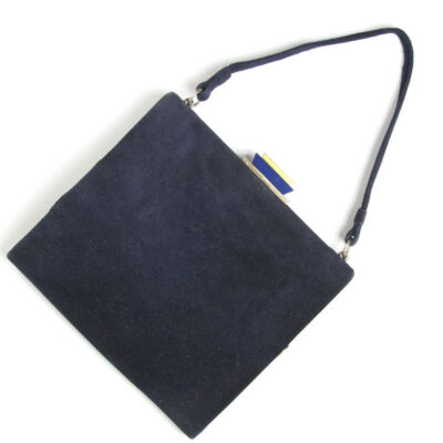 Back of navy suede handbag