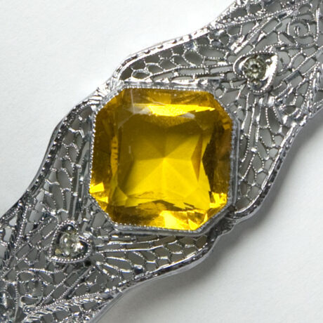 Close-up view of cushion-cut, citrine-glass stone